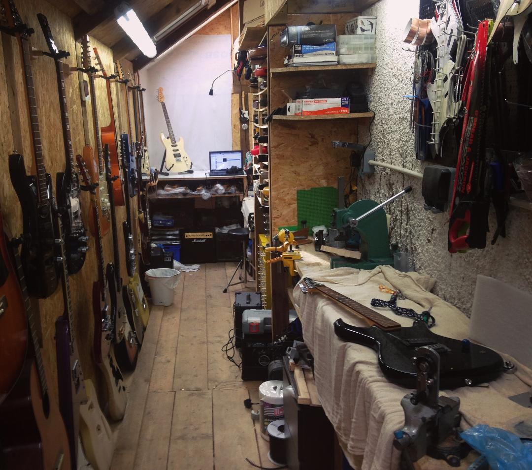 Our workshop full of tools and guitars